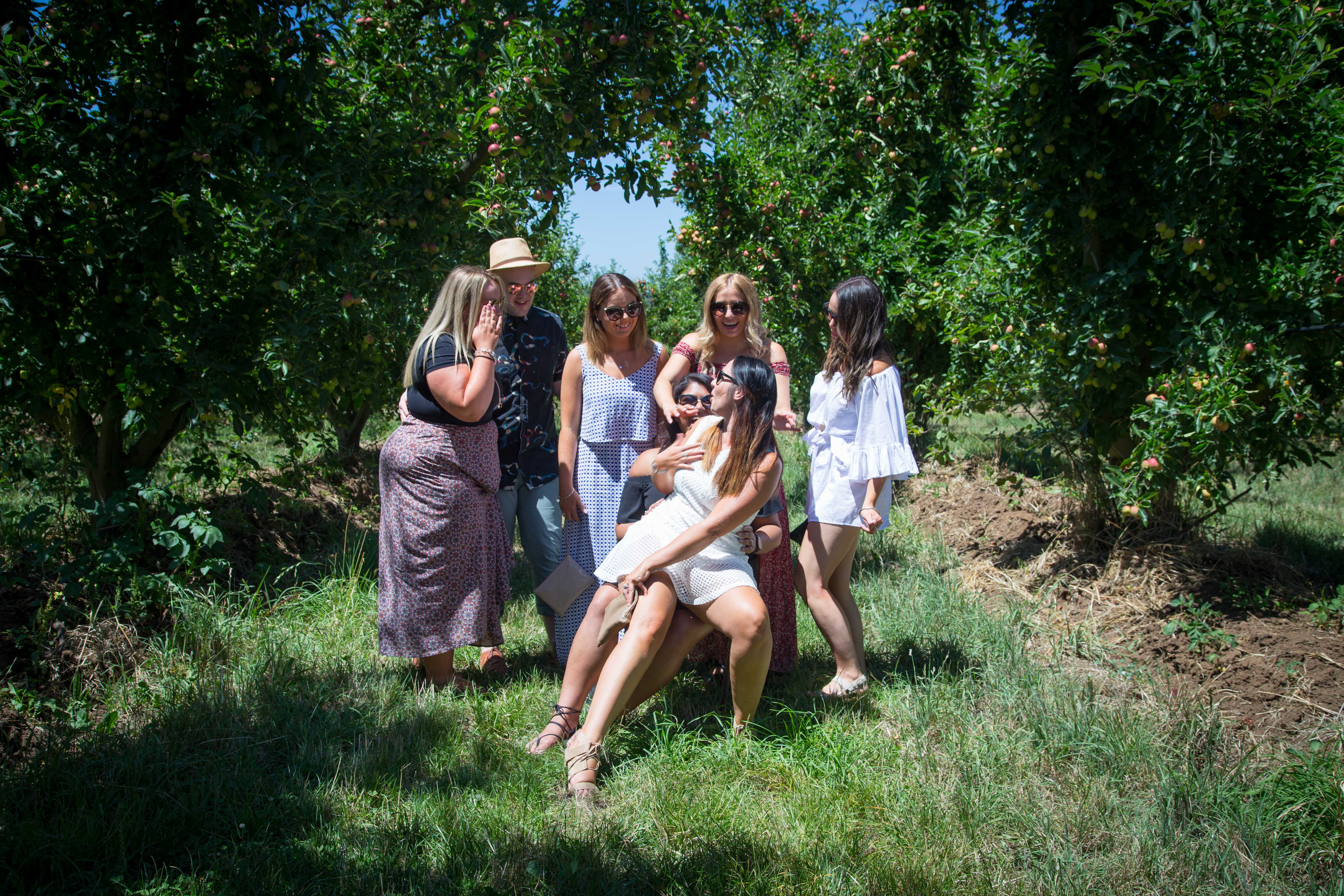 Group photo in the orchard at Mock Red Hill